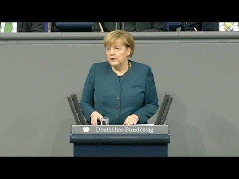 Tough-talking Merkel urges EU treaty change in first speech of new term