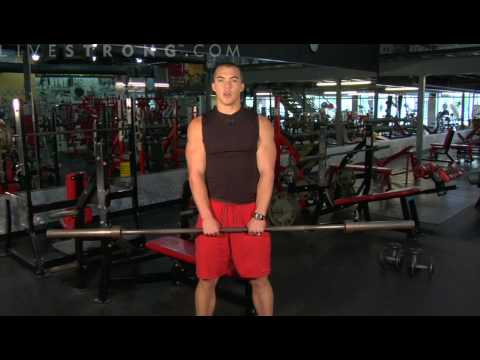 upright - Work the trapezius muscle using upright barbell exercises. Learn tips and techniques for working out the chest, back, shoulders, and arms in this weightlifti...