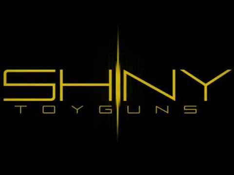 Tekst piosenki Shiny Toy Guns - I Owe You A Love Song po polsku