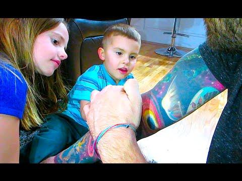 KIDS INSPECTING TATTOOS!