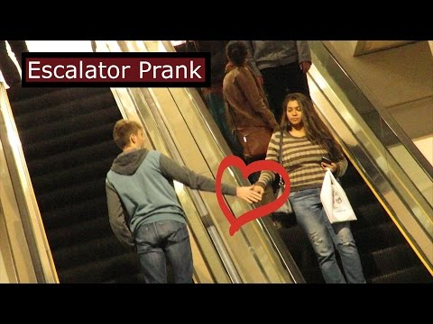 Touching People's Hands On The Escalator