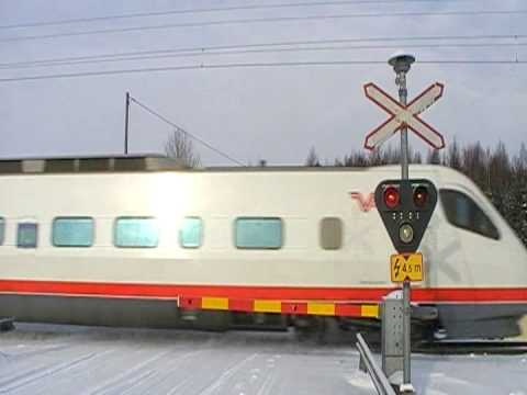 Finnish Pendolino 1 passed Lahdenkylä level crossing