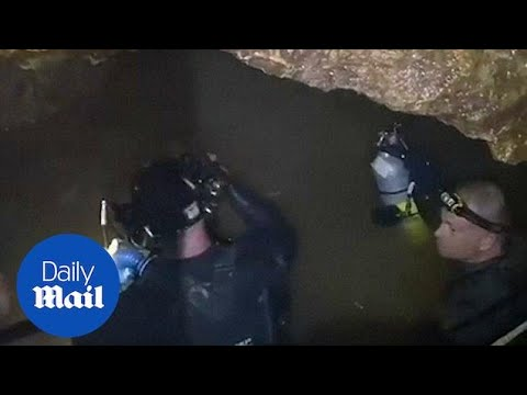 Rescue mission: Footage emerges from depths of flooded Thai cave - Daily Mail