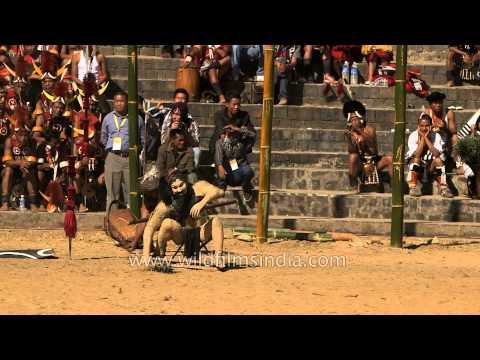 Konyak tribe demonstrates how they do head hunting!