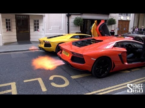 dual - Oh. My. God. One Aventador firing out flames is cool, but two is just EPIC! Two of Lamborghini's V12 beasts were in London together visiting Harrods when the...