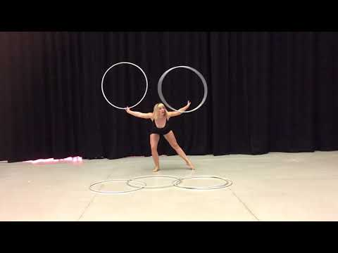 Circus Performer Does a Mesmerizing Performance With Six Hula