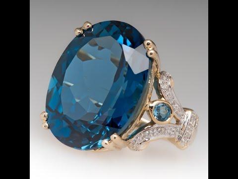 20 CARAT BLUE TOPAZ & DIAMOND RING 14K