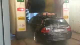 Crazy Man Coming With His Car Into The Car Wash