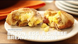 Get the recipe for Bacon, Egg and Cheese Breakfast Bombs at: http://allrecipes.com/recipe/258039/bacon-egg-and-cheese-breakfast-bombs/ Every bite explodes with awesome breakfast flavors in this delicious handheld cinnamon bun bomb! Roll cinnamon rolls from a tube into thin circles, then load up with cream cheese, scrambled egg, Cheddar cheese and crumbled bacon. Wrap together, brush with butter, and bake until golden. Everyone will drop their cover for a breakfast that's truly the bomb!Subscribe to Allrecipes @ http://www.youtube.com/subscription_center?add_user=allrecipesAllrecipes Magazine is now available!U.S. subscribers, subscribe here: http://armagazine.com/subscribenowCanadian subscribers, subscribe here: http://themeredithstore.ca/p-282-allrecipes-subscription.aspxFacebookhttp://www.facebook.com/AllrecipesTwitter @Allrecipes