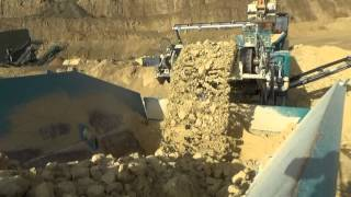 Powerscreen train incorporating mobile cone crushers and mobile screens