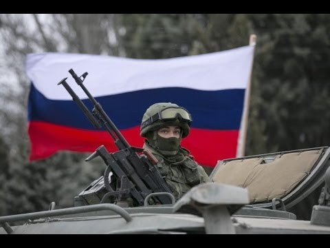 polit - http://www.democracynow.org - Russian President Vladimir Putin is rebuffing warnings from the U.S. and European Union as the crisis in Ukraine threatens one ...
