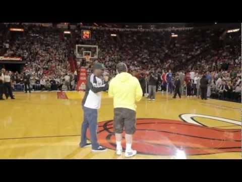 LeBron James tackles fan after hitting a half-court shot for $75,000