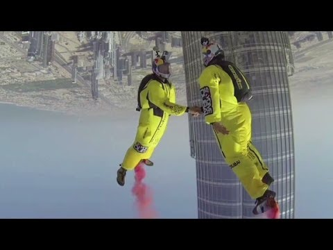from - Veteran BASE jumpers Vince Reffet and Fred Fugen break a world record by BASE jumping off the world's tallest building.