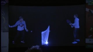 Caroline Wozniacki and Marsel Ilhan are on the same stage together with hologram technology
