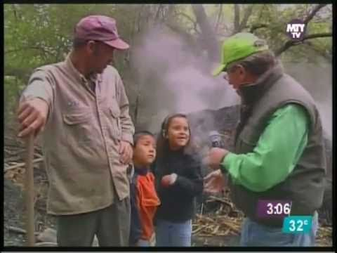 Charcoal production in Mexico, in earthen...