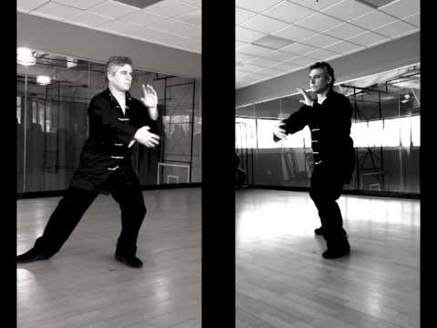 sxs 1 - Sifu Marc Sabin demonstrating beginner's Tai Chi. Side by side view.