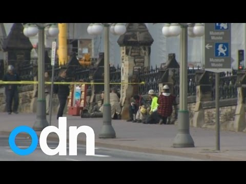 shooting - The Canadian capital of Ottawa is in lockdown as police search for up to three gunmen after one was reportedly shot dead inside Canada's Parliament. Report by Claire Lomas.