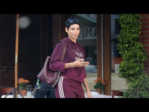 Nicole Murphy Looks AMAZING In Maroon Sweats While Shopping In Beverly Hills