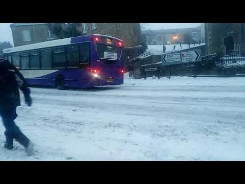 Public bus stuck in snow. Frome