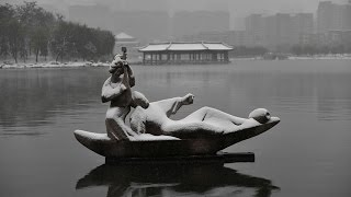 """The Northwest Chinese city of Xi'an in Shaanxi province welcomed the first snowfall of the season on Tuesday. This artistic black-and-white photo captures a tranquil moment in the ancient Chinese capital blanketed by snow, Nov 22, 2016. Xi'an ([ɕí.án] ( listen); Chinese: 西安; pinyin: Xī'ān), formerly romanized as Sian,and also known as Chang'an ([ʈʂʰǎŋ.án] ( listen); Chinese: 長安; pinyin: Cháng'ān) before the Ming dynasty,[1] is the capital of Shaanxi Province, People's Republic of China. It is a sub-provincial city located in the center of the Guanzhong Plain in Northwest China.One of the oldest cities in China, Xi'an is the oldest of the Four Great Ancient Capitals, having held the position under several of the most important dynasties in Chinese history,including Western Zhou, Qin, Western Han, Sui, and Tang.Xi'an is the starting point of the Silk Road and home to the Terracotta Army of Emperor Qin Shi Huang.Since the 1990s, as part of the economic revival of inland China especially for the central and northwest regions, the city of Xi'an has re-emerged as an important cultural, industrial and educational centre of the central-northwest region, with facilities for research and development, national security and China's space exploration program. Xi'an currently holds sub-provincial status, administering 9 districts and 4 counties.As of 2015 Xi'an has a population of 8,705,600 and the Xi'an-Xianyang metropolitan area has a population of 13,569,700.It is the most populous city in Northwest China, as well as one of the three most populous cities in Western China.According to a July 2012 report by the Economist Intelligence Unit, it was recently named as one of the 13 emerging megacities, or megalopolises, in China.The report pinpoints and highlights the demographic and income trends that are shaping these cities' development.The two Chinese characters """"西安"""" in the name Xi'an mean """"Western Peace"""". During the Zhou dynasty, the area was the site of the national capital, w"""