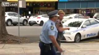 Bloke with a beer bottle heckles cop during interview ..... comes off second best