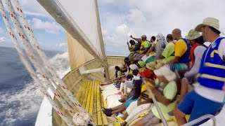 We tangled our mast in their rigging. We nearly sank! We had an amazing day! Anguilla Boat Racing is VERY exciting and I was...