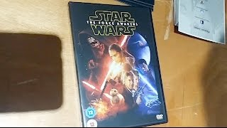 Phoenix James autographs new Star Wars: The Force Awakens DVD