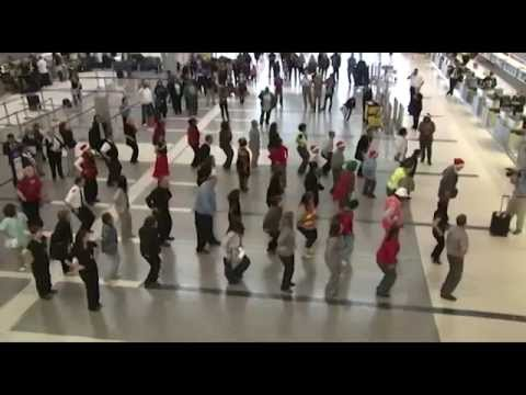 flashdance - On Dec. 15, 2010, hundreds of unsuspecting passengers at LAX's Tom Bradley International Terminal witnessed a surprise Christmas Flash Dance performed by doz...