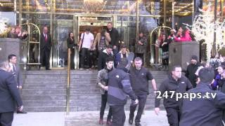 One Direction checking out from the Trump Hotel in NYC