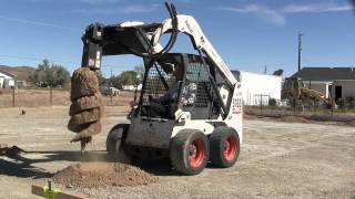 4. Digging holes With a Bobcat auger attachment