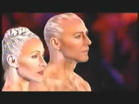 CIRQUE - Clip from Cirque Du Soleil's 20th Anniversary called 'Midnight Sun'. Filmed in July 2004 in Montreal. The song is 'Mer Noire' - but its a special Midnight Su...