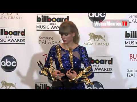 poses with her Awards backstage at Billboard Music Awards 2013