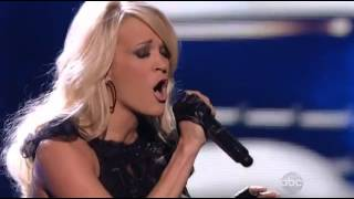Carrie Underwood - Two Black Cadillacs (At American Music Awards 2012) (Live) lyrics (French translation). | Two black Cadillacs driving in a slow parade