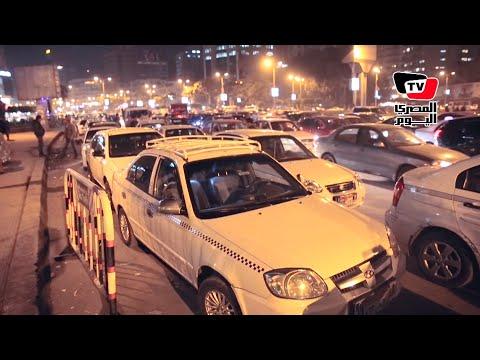 سائقوا التاكسي الأبيض يتظاهرون ضد «أوبر» بـ«مصطفى محمود»
