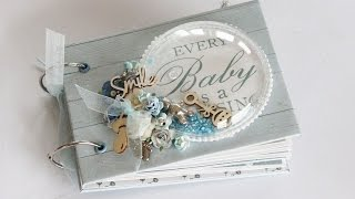 A simple mini album created for photos from a baby's first year. Created with Kaisercraft's Peek A Boo collection.