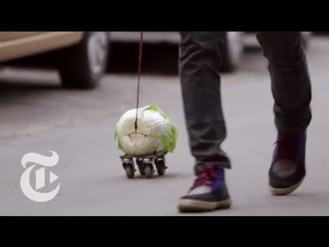 Why Is This Man Walking With a Cabbage? | The New York Times