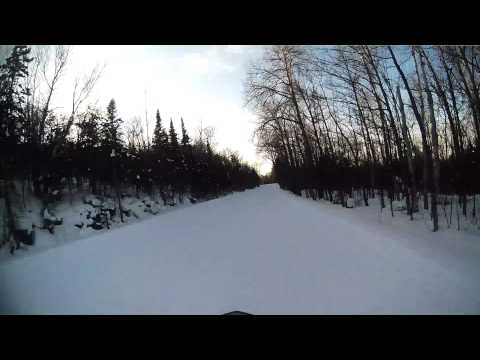 Riding snowmobile up to Lake of the Clouds Porcupine Mountans MI on trail 1 (видео)