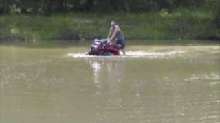 9. 2006 Arctic Cat 500 playing in pond