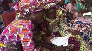 Buhari meets 21 freed chibok girls