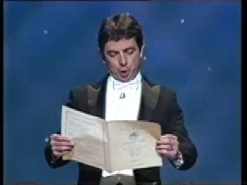 Atkinson - Rowan Atkinson (as Robert Bennington) performing the European Anthem in German...until he runs out of words at the end of the first verse.