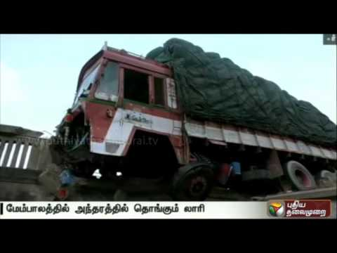 Lorry-from-Hyderabad-hanging-precariously-over-railway-track-at-Virudhunagar
