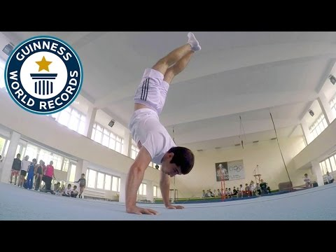 WATCH: Man Breaks Guinness World Record For Most Handstand Pushups In A Minute
