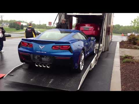 Corvette - At the end of the National Corvette Museum's 2013 Bash, the C7 Corvette Coupe and Convertible were moved outside and loaded into a transporter. Driving the C...