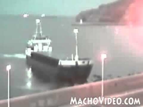 ship runs aground - Cargo Ship hits the shore.