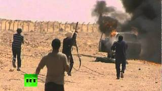 Footage filmed on the road to Sirte on Monday allegedly shows rebel fighters capturing two suspected Moammar Gadhafi loyalists ...