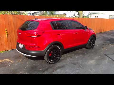 2015 kia Sportage on Black 20 inch rims.
