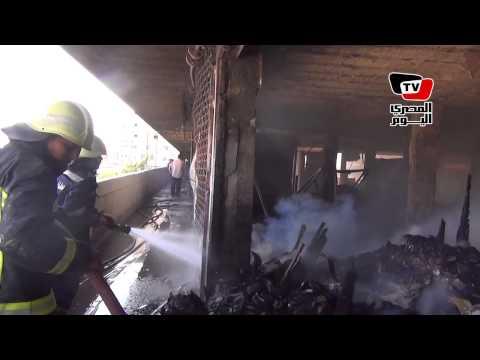 قوات الحماية المدنية تسيطر على حريق محال دوران شبرا