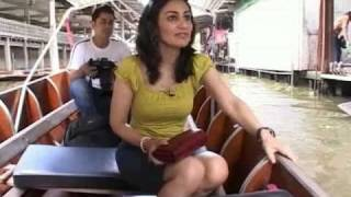 Shopping At Bangkok's Floating Market