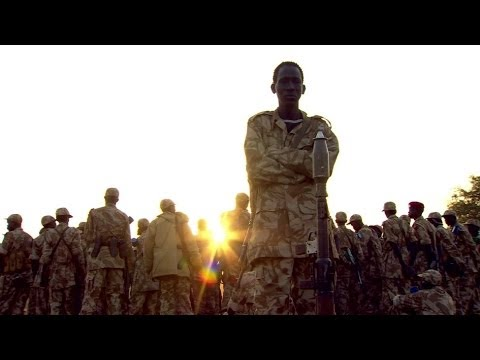 South sudan - Dramatic footage captured by the BBC's Alastair Leithead & cameraman Jack Garland who were with government troops advancing to the front line just outside Bo...