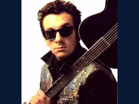 Tekst piosenki Elvis Costello - American Without Tears po polsku